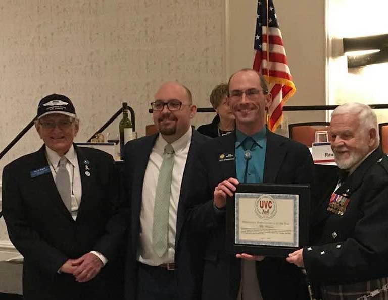 Receiving a Legislator of the Year Award from the United Veterans Committee of Colorado.